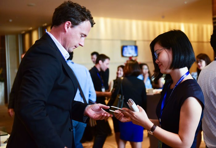 Häfele's representative exchanges business cards with an event participant